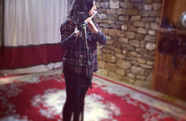 Charlotte recording some flute sounds at the recording studio
