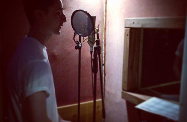 Kieran recording some vocals at the recording studio